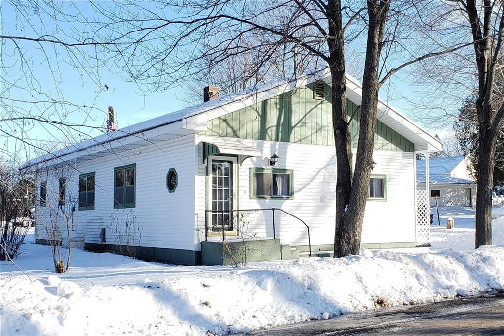 Spacious pre-inspected 3 bedroom 1-1/2 bathroom near the Holcombe flowage and Holcombe School! Attached garage is an over  sized one car with a storage area off the back. Many well maintained flower beds and a deck overlooking the backyard.    New well Dec 2019.  New furnace Jan 2018.  New shingles 2010.  New oil furnace 2018.  Shower in the basement.