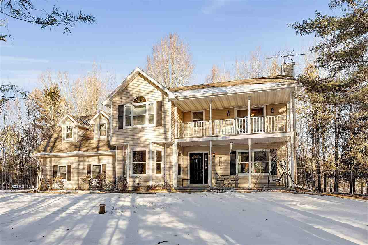 You are sure to be impressed by this beautifully maintained home and large 5.4 acre wooded property full of wildlife! Follow the beautiful trail that leads to fire pit, volleyball court, horseshoe pit, apple trees. This home boasts a beautiful master suite with private deck, fireplace, and large en suite bathroom. You won't run out of storage with the large walk in closets and HUGE detached garage. 40'x72' addition added to the 24'x24' detached garage in 2017. Sellers chose to have laundry upstairs, but there are hookups in the pantry on main floor. Come see it for yourself!