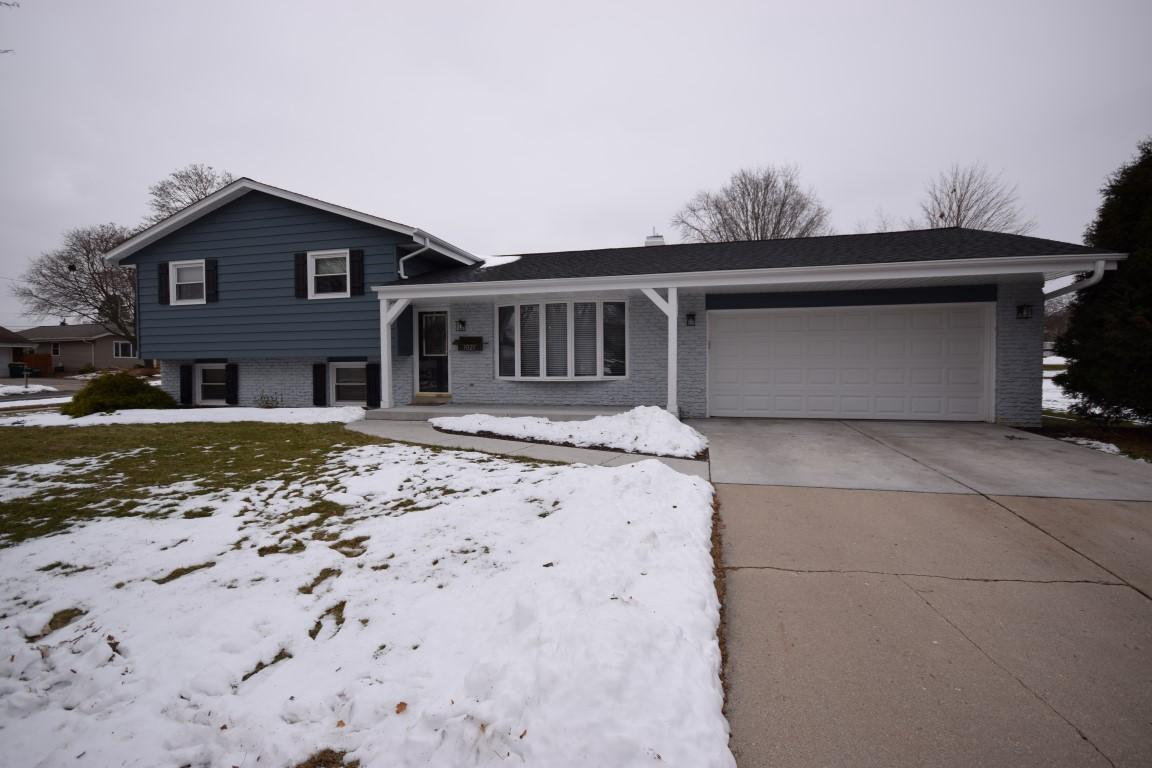 Meticulous, fully  updated 3 BR, 2 BA home located near West Bend high, schools. Entire kitchen remodeled in 2019 w/all new appliances, maple cabinets & soft pull drawers, as well as remodeled bathroom.  Hardwood floors throughout main level.  Huge lower level family room with built in wood burning fireplace, laundry room, & full bath. Living room, kitchen, bathroom & laundry room all freshly painted in 2019. Newer furnace, water heater, washer & dryer. New light fixtures inside & outside.  Large yard on all four sides w/ re stained deck in 2019. Professionally landscaped. New concrete driveway in 2017, new garage door & openers in 2019. Plus nice large basement for lots of storage space.  Nothing to do but move right in.