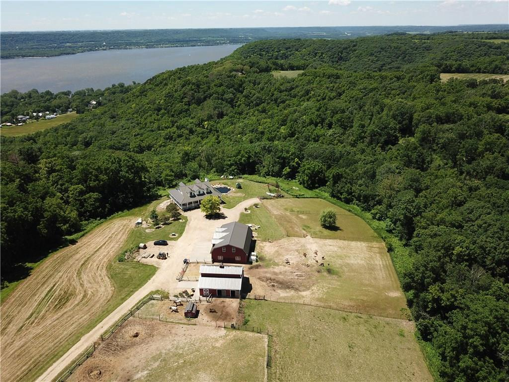 Hobby Farm on 23.24 acres w/ Views of Lake Pepin/Mississippi River 1 direction & your animals the other. 30x36 6-stall barn w/hay loft. 48x36 gar w/stairs to full storage above. 9' walls + vaulted liv rm. Grmet kit has 7x7 island. Wood burning fplc. Mstr ste has lg BA (W/I shower & claw foot tub) & closets. Main lvl lndry & pantry. W/O LL leads to swimming pond. Geo-therm heat & A/C. CVAC & air exch. 8' covered porch all 4 sides! Nice fencing for pasture areas. Nice tillable & wooded acres.