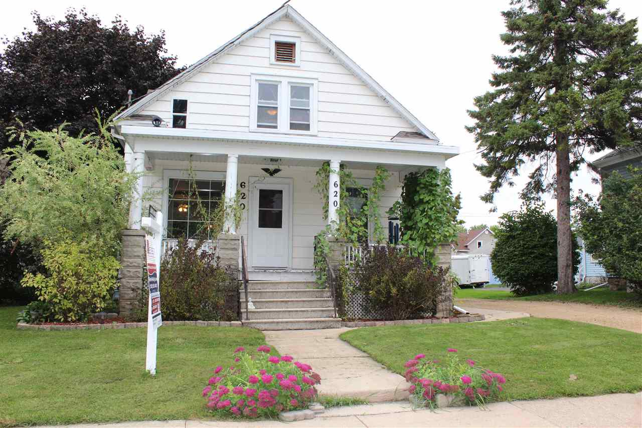 New Pictures! Don't miss this nicely maintained, beautiful Victorian home to build memories. Centrally located. Home is roomy, large living/dining room, perfect for entertaining. Upstairs includes family room plus extra kitchen with endless potential. Many updates, renovations include refinished original wood floors, stairs and trim, new furnace 2017, garage roof 2018, second floor windows, electric updated, full basement with laundry area. 2 car garage with loft. Enjoy a fire in your secluded fenced backyard, eat some raspberries and strawberries and plant your favorite veggies in the garden.