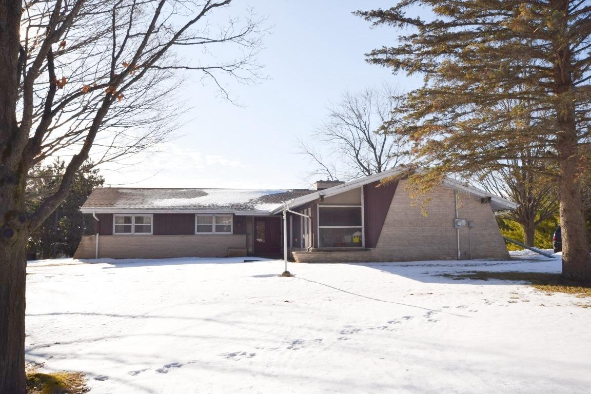 Come see this 3 BR, 1.5 BA sprawling ranch home on almost 2 acres with incredible views and large outbuilding. Features include vaulted ceiling in family room, gas fireplace in living room open to eat in kitchen.  hardwood floors in bedrooms, first floor laundry.  Large bath with double sinks and walk in tub and shower. Huge lower level rec room, pellet stove to help with heating costs.  Huge covered patio in the back with great views of the city.  Private tree lined backyard with tons of wildlife.  updated 200 amp electric. Newer water heater. Call today!