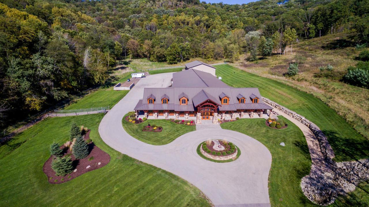 World Class Equestrian Property! Located on 174 Acres surrounded by the WI bluffs & views of the La Crosse Country Club Golf Course. The home was custom built with luxury & comfort in mind with state of the art amenities, geothermal heating & cooling, and amazing views from every window. The horse barn of your dreams! 9 cedar lined horse stalls with interior & exterior access, private tack room, 2 horse grooming stations,  indoor arena, plus an extraordinary viewing room! Barn also includes an office, recreation room, & separate 1 BR apartment. Truly an exquisite horse property.