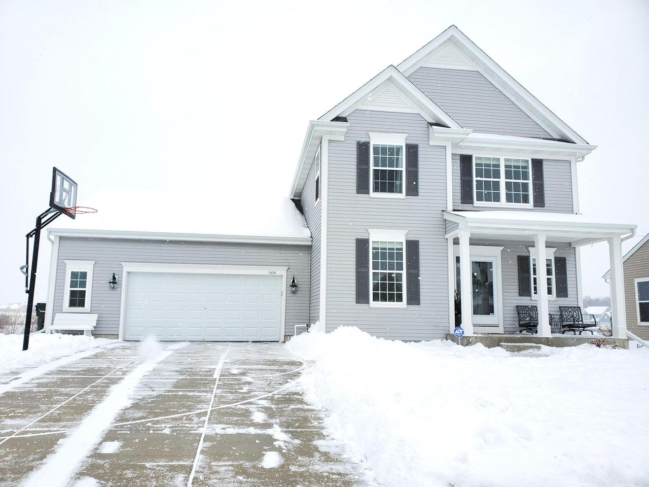 This warm and inviting 4 BR, 3.5 BA home is sure to impress and offers a SPECTACULAR view!The main level has an open concept Great rm, kitchen, dinette area. There is a flex room on the main level that can be used for various things- office, den, playroom ect.The garage is drywalled/insulated and OVERSIZED and  enters into the convenient locker style mudroom. In addition to the 3 bedrooms upstairs there is a loft & deluxe laundry room. The 4th BR w/ egress window is located in the nicely finished lower level that includes a full bath and family/ rec rm along with plenty of room for storage. Additional features include a home air to air exchanger, reverse osmosis system & an outdoor sprinkler system.You will not want to miss this one!