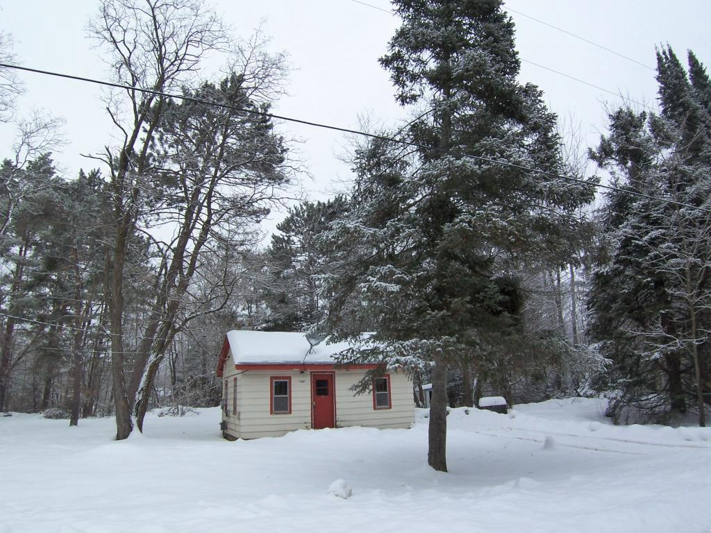 """Looking for a """"Tiny Home""""  in the Northwoods, this is one dynamite location outside of Webster, even hooked to city sewer. Lots of room for a huge garage w/bunkhouse for more sleeping space! Bathroom remodel includes new toilet and bathroom flooring is scheduled to be completed. Great buy!!"""