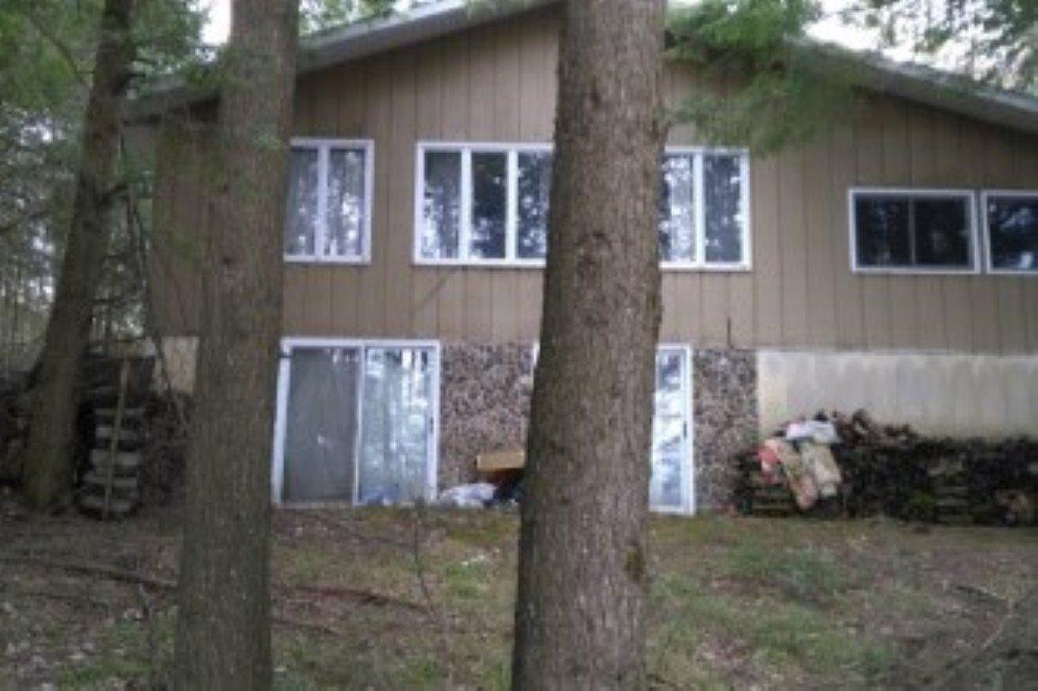 2 BDR. LAKE HOME IN THE NORTHWOODS!   This property has 350 ft.of frontage on Lake 19, one of northern Wisconsin's best kept secrets;  Less than 1 mile from thousands of acres of National Forest hunting land; Lake 19 is a private lake with no public access except for the other private owners on the lake;  Lake 19 is approx. a 17 acre lake, with a maximum depth of 53 ft.; This property is also located within a mile or two of two other great fishing lakes;,Property includes a 3 season porch, 2 fireplaces  and an attached 1 car garage.  Property also includes a full log guest cabin.                                                     This property does need some TLC and a lot of the value is in the access to a pristine, virtually private lake. This Information Is Compiled From Miscellaneous Sources And Is Believed Accurate But Not Warranted. Neither The Listing Broker Nor its Agents, Subagents Or Property Owners Are Responsible For The Accuracy Of The Information. Buyers Are Advised To Verify All Information.