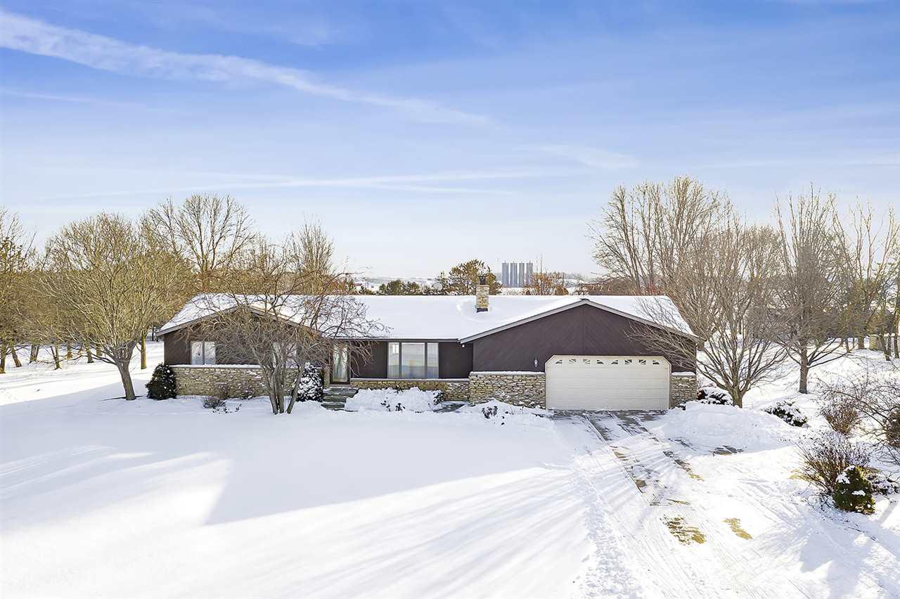 Excellent opportunity for hobby farm enthusiasts or on-site business with this 10+ acre setting offering several outbuildings including 2 hoop houses, 3 detached garages, 60x30 outbuilding, gazebo, pond stocked with Perch, Crappie and Bluegill maximum depth of 28?, 2 driveway entrances with plenty of parking and approximately 1300+? of highway frontage. Horses and livestock are welcome. Well maintained custom built ranch home with a finished lower level, spacious principal rooms, wood burning fireplace, 1st floor laundry and entertaining deck. Owner gets compensated for billboard space.