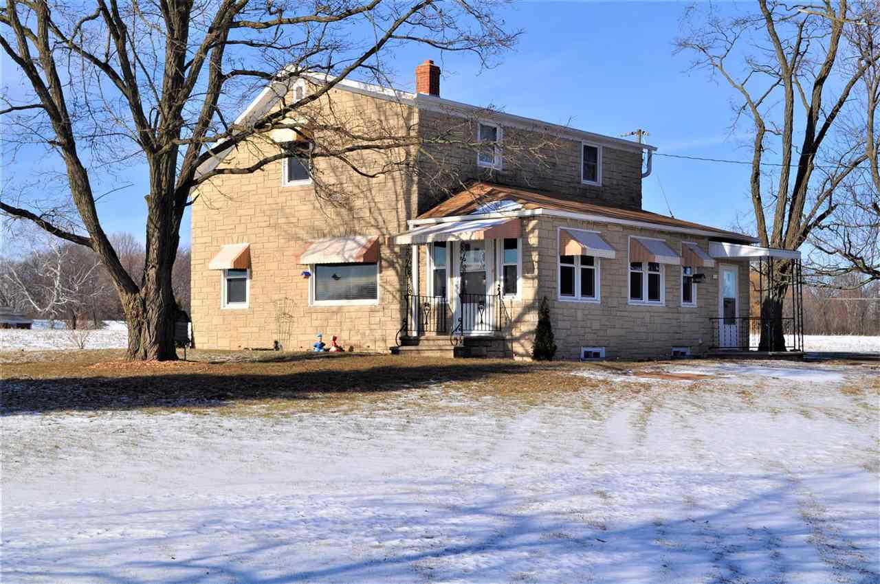"""Farm With Great Development Opportunity! Cute turn of the century farm home in good condition w/multiple buildings and a large barn. 42 ac (p/assr) just off the Hwy 29 and FF intersection. Per the Village, water and sewer are nearby and they will work with a developer to extend services. Per Howard's preliminary plat, the 32.7 ac N of Woodland would include approx 75 residential lots and the 9.5 ac S of Woodland would be used as commercial. Perfectly positioned being close enough to all conveniences, but far enough out to give you a country feel! 2 ac w/improvements zoned """"Other""""."""