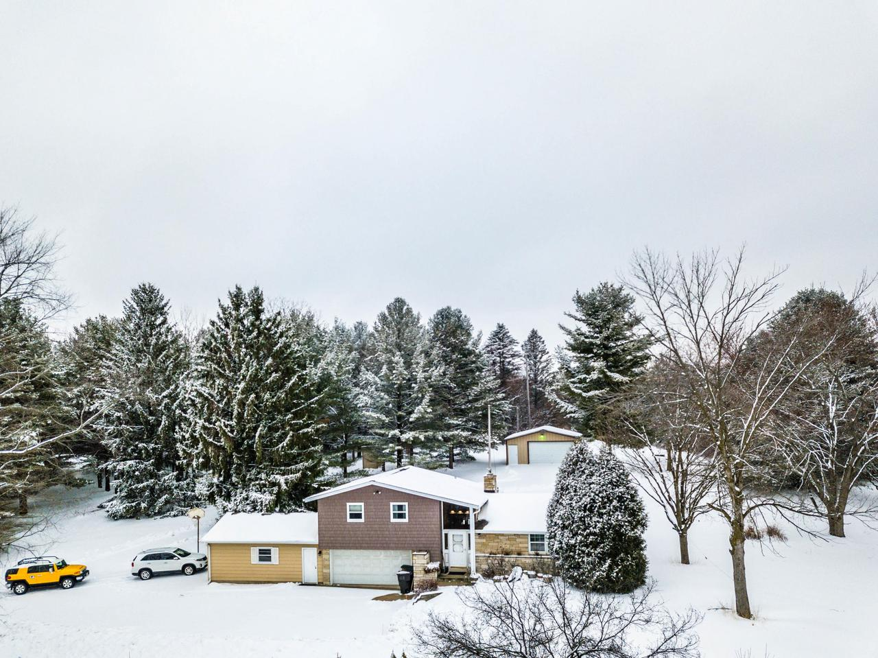 Don't miss this opportunity to own this 3 bedroom home set on a beautiful 5 acre park like lot in the town of Mukwonago.  Home features 2.5 car garage with lift for ATV's or other small toys, large air compressor.  26x27 outbuilding with electricity, plenty of room for horses, wood burning stove in basement,  new septic system 2014, new furnace 2012, new roof 2010.  This home will not last long.  Schedule your showing today.