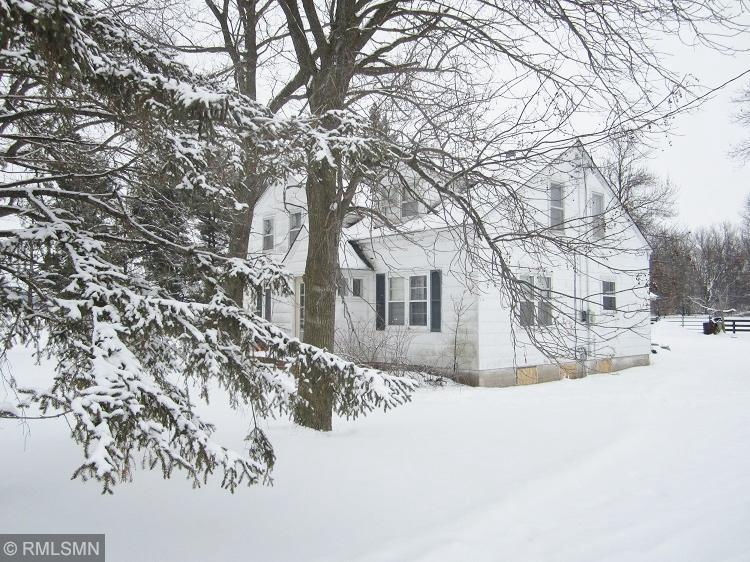 """A 7.1 Acre Horse Friendly Place with 5 BR, 1/1/2 Bth, 2 story  and 5 additional bldgs. The property is estate being sold """"As Is"""". Work needed on exteriors. Wood bordered paddocks, 2 box stalls, 6 stalls, hay mow. Pump House -  Garage/Man Cave, Milk house, extra barn, and lots of opportunities. All this on the edge of Hammond. Quick Close Possible."""