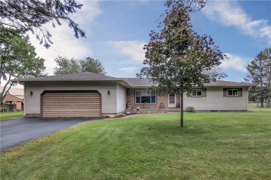 Ranch home with finished basement,vinyl windows,upper and lower level wood fireplaces, new septic,2 car attached garage,heated 36 x 72 pole shed with 12 x 34 canopy and partially heated floor,60 x 102 stable with 60 x 74 riding arena,10 horse stalls with rubber matts, tack room,3 Nelson and 1 Ritchie water cups,4 wind breaks and all located on 17.54 acres of land within minutes of Eau Claire.