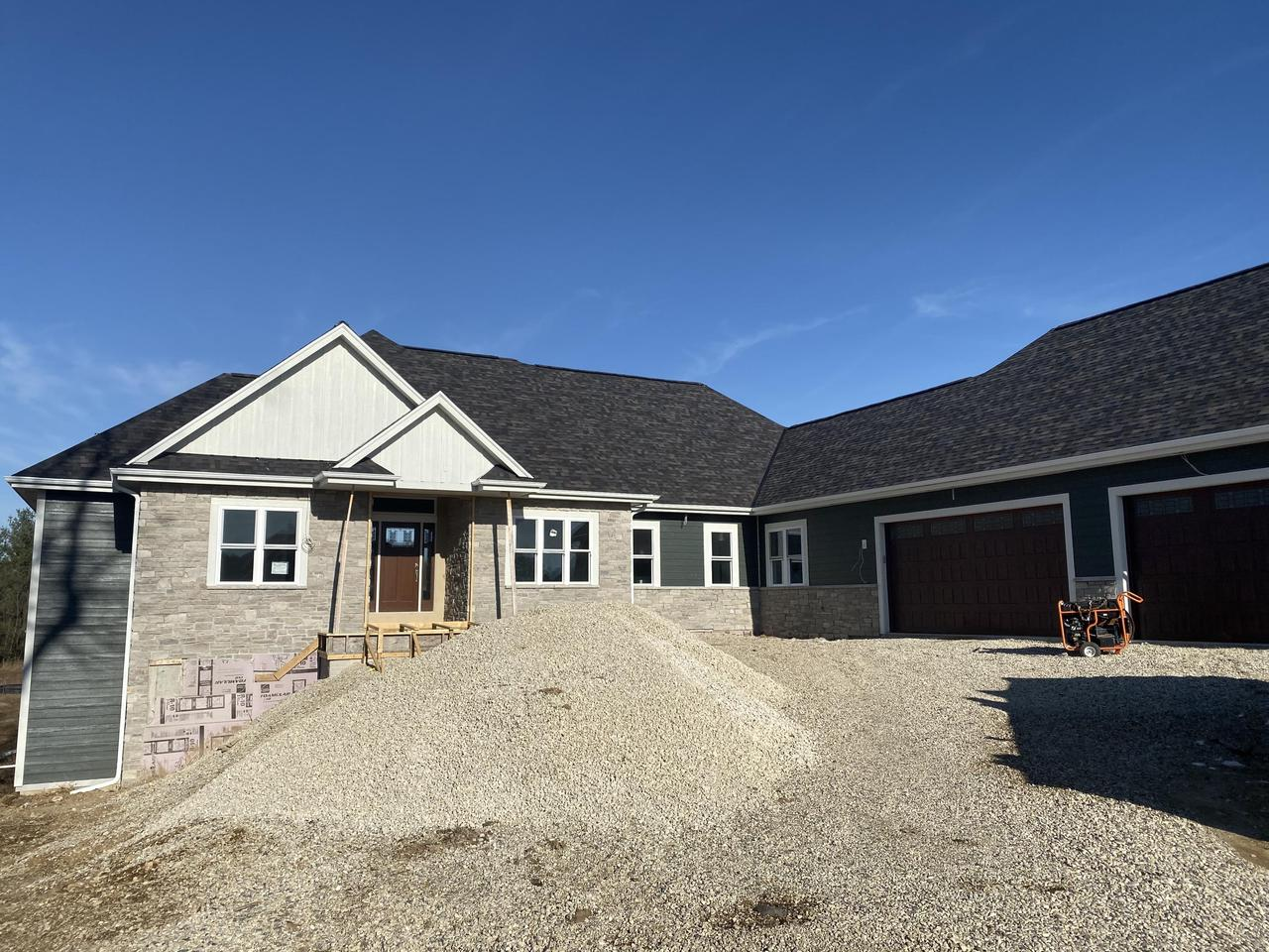 Brand NEW, custom built split ranch home in the Whispering Heights Subdivision. Sitting on 1.25 acres of land. Open concept, solid white oak flooring, large living room with gas fireplace, Jack and Jill bath with ceramic tile flooring. Master bedroom suite with large walk-in closet, nearly all marble master bathroom with walk-in shower and separate tub and quartz countertops. Spacious, walkout basement stubbed for a full bathroom awaiting your finishing touches! All of this is completed by a 3 car attached garage, a bonus room, mud room and laundry room all on the main level.