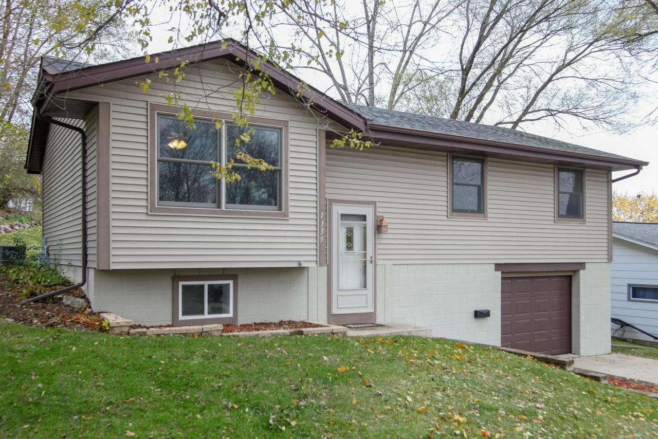 Well kept and recently updated 3-4 bedroom home which is close to the city park, schools and shopping!  Only a major life change brings this home back on the market so quickly.  All the flooring on the main level is new along with the baseboard and trim.  All bedroom doors are newly replaced and closet doors.  Nicely designed and updated kitchen with oak cabinets.  Open concept on the main level with a full bath and beautifully tiled shower and tub area.  Patio door from dining area to back patio for summer entertaining.  LL has 4th bedroom along with half bath and laundry.  Garage has a heater for winter working, plus lots of storage.  Home warranty included.  Must see!