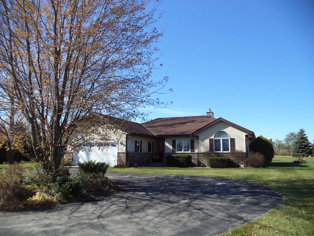 Pride of ownership in this 3 BR 2.5 BA ranch on 9 acres in Slinger School District. Kitchen features newer granite countertops, (2015 per seller) beautiful wood laminate floor & appliances included. Enjoy breakfast in the light filled dinette off the kitchen that also leads to southerly facing deck. Living room has a gas fireplace & vaulted ceiling. Master suite featuring its own gas fireplace, jetted tub in the bath & walk in closet. In the lower level you'll find a large rec room with additional gas fireplace, a den and a half bath. Relax on the concrete patio that was installed in 2016 overlooking the private backyard. Other updates per seller include furnace in 2015 and roof & gutters in 2016. You'll love the extra storage room outside with the garden shed & 2.5 car heated detached GA.