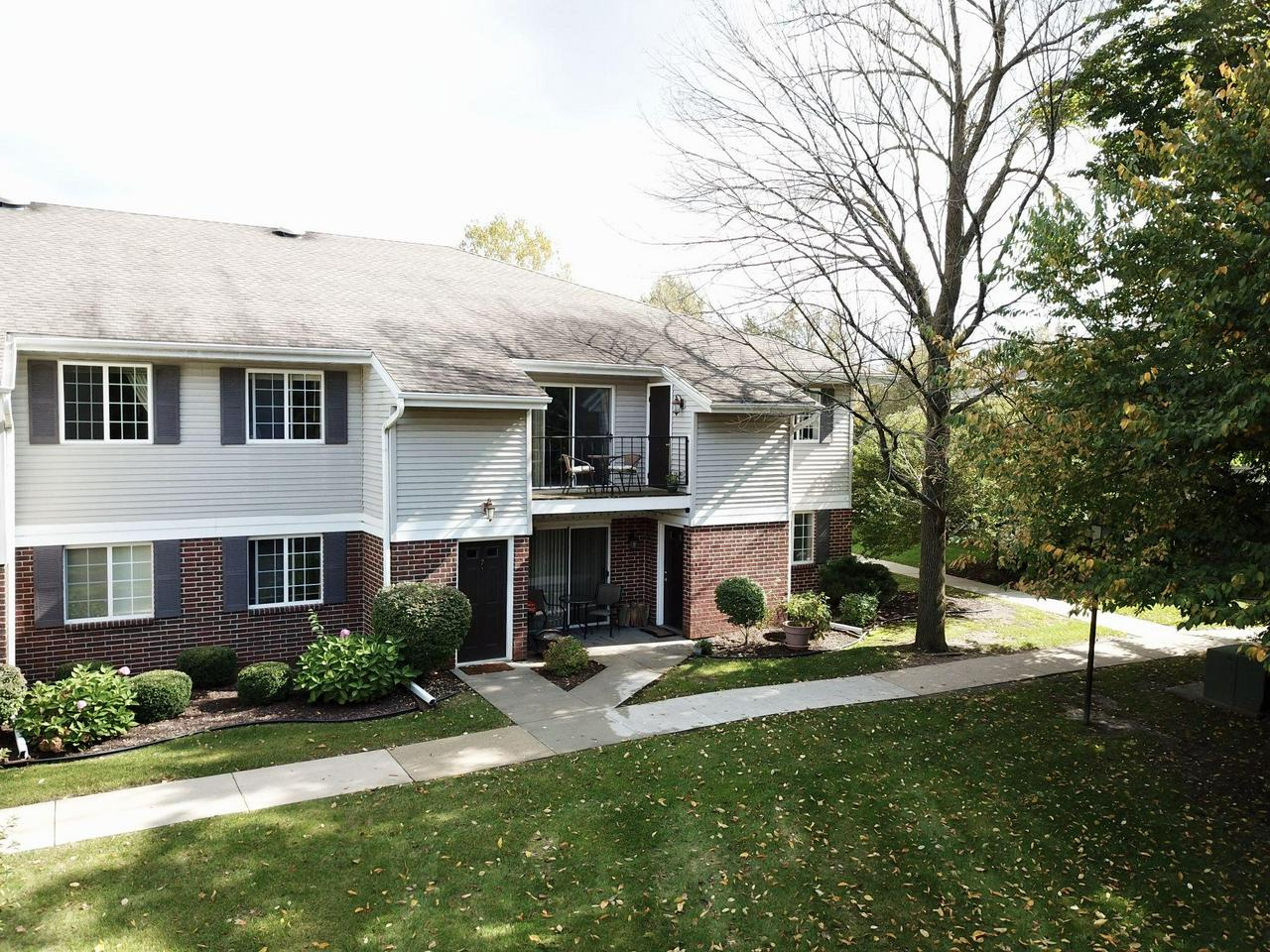You'll fall in love with this beautiful condo situated in the highly sought after Asbury Woods.This upper unit features:  private balcony overlooking manicured green space, spacious welcoming living room with vaulted ceiling, kitchen with stainless steel appliances and loads of cabinets, two generous size bedrooms, master with private bath and walk-in closet, 2nd full bath with tub, in unit laundry, 1 car garage plus assigned parking spot, lots of storage and is pet friendly. Easy access to shopping, parks and highway. Truly a great find!