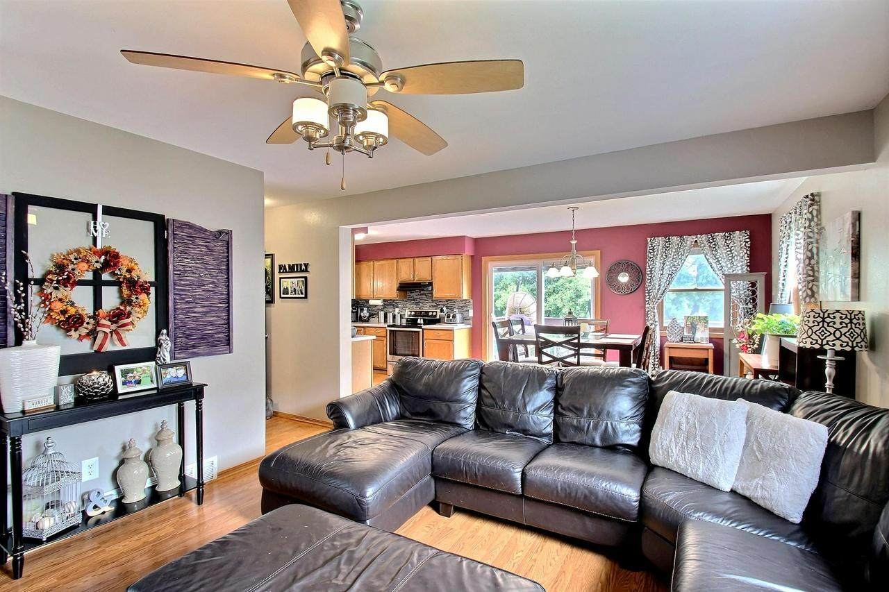 Don't look any further, this meticulously maintained home is move in ready! Open concept layout makes entertaining easy. Updated kitchen featuring new backsplash, appliances, granite double sink, lighting and patio door. All 3 bedrooms upstairs are equipped with new flooring & trim throughout. Finished lower level family room with new flooring and patio door that leads out to large backyard. Enjoy the built-in fire pit during chilly fall nights. Spacious storage shed for all your extra storage. Conveniently located near restaurants & shopping. Call today for your private showing! Home Warranty Included!!! New roof 17' & Garage door w/ opener 16'. (See document tab for all the updates). Back on Market do to Buyers Financing