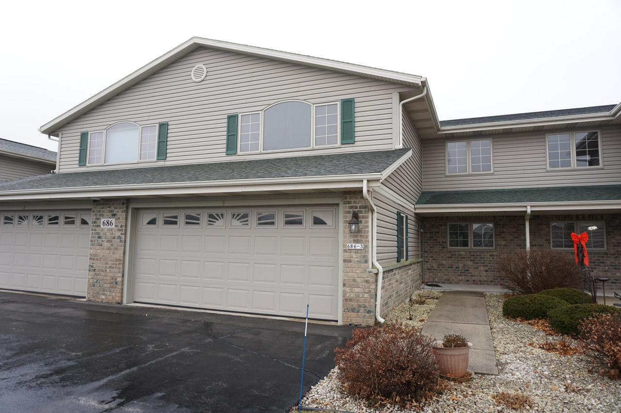Enjoy condo living at it's finest in this Open Concept Style 2bbr/2.5ba/2.5 car attached garage with amenities galore.  Enter the spacious Kitchen/Dinette combo w/appliances. Great Room boasts vaulted ceiling, Gas Fireplace and patio doors leading to a private deck. First Floor Laundry and powder room.  Master Bedroom offers WIC and full bath. Additional bedroom and full bath on upper.  Highly  desirable condo development featuring super location, close to shopping, restaurants and freeway. Don't miss out on this super condominium.  Vacant for easy showing. Schedule your viewing today.   Pet Policy: 1 pet less than 20lbs, no more than 2 neutered cats