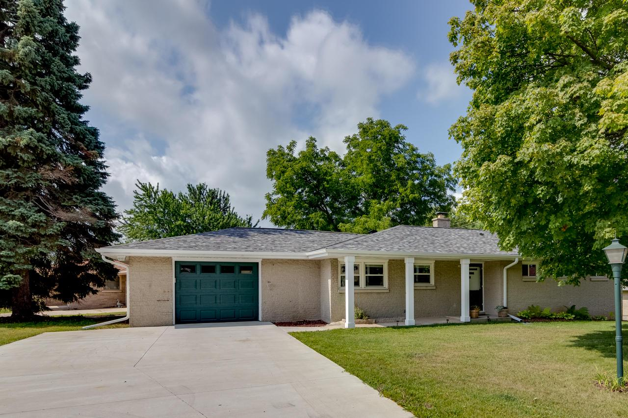 Solid brick ranch 3 bedroom 2 bath home on West Bend's Southwest side. Completely renovated - New roof - New gutters and downspouts - New driveway - New garage door with electric opener - New windows - New carpeting in living room and hall - Newly refinished hardwood floors in all three bedrooms - Custom Hunter Douglas window treatments in kitchen and living room - New refrigerator, microwave, electric range, and dishwasher - Updated cabinets and new counter tops in kitchen - New cabinets and counter in main level bath - New plumbing fixtures in kitchen and both bathrooms - Wide open basement, ready for your ideas! Within short walking distance of Rolf's Dog Park and Decorah Hills Park.