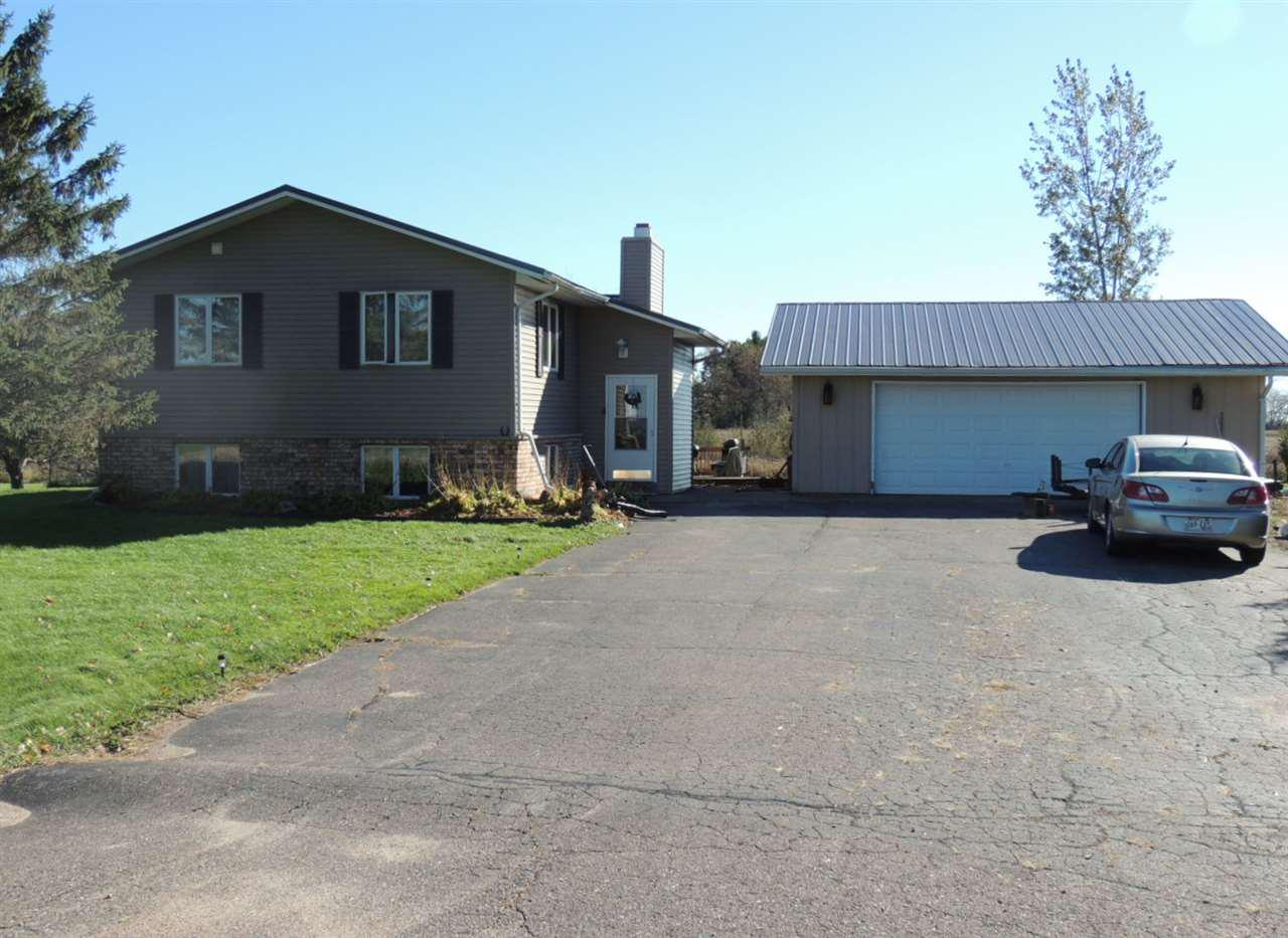3 bed 2 bath home just on the edge of the city of Antigo, and located on a private dead end road. Large living room and dining area with deck over looking back yard. Finished lower level offers rec room with wood fireplace, bar area with walkout to back yard, bedroom, full bath and laundry area. This home has many recent updates including new metal roof, vinyl siding, and a brand new furnace. You won't beat this location! COME SEE!!