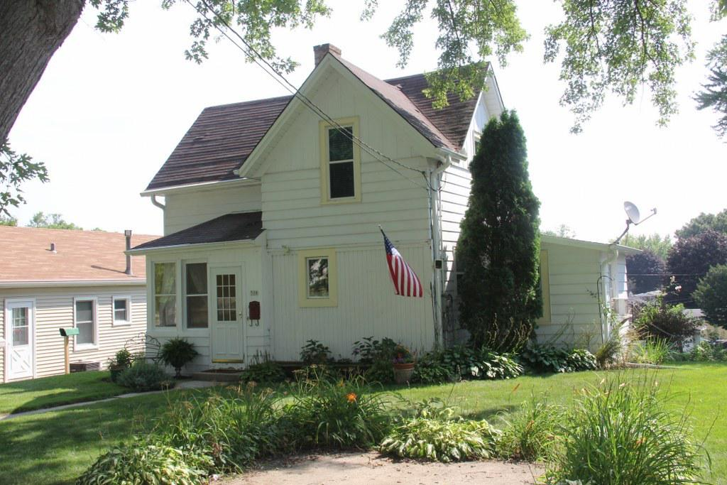 Charming low maintenance 2 story, lots of character & functionality at an affordable price.  Situated in the perfect location for walking to schools, local sporting events, fireworks, outdoor swimming & downtown.  Enclosed front porch, wood flooring opens to open concept FR, eat-in KIT featuring wood laminate flooring and window over the sink.  Newer KIT counter tops & newer windows thru out.  Main floor BR and bonus main floor Den, which boasts a beautiful wood ceiling.  Main floor full BA.  Partial open staircase leads to additional 2 spacious BR's  with vaulted ceiling & wood floors.  Spacious closets.  LL offers big windows & walk out door to backyard & leads to detached garage.  Updated electrical.  Driveway easement off W. Washington St. & a convenient parking spot on Cedar St.