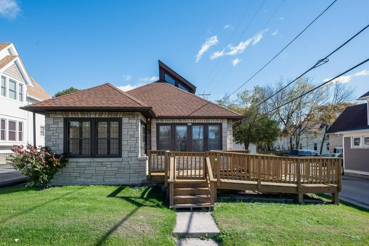 TIMELESS CLASSIC ! MILWAUKEE BUNGALOW WITH AWESOME WEST BEND LOCATION ! ACROSS THE STREET FROM THE EISENBAHN TRAIL  AND A SHORT HOP, SKIP, AND JUMP TO A REVITALIZED DOWNTOWN ! ALL STONE BUNGALOW FEAT. 3 BDRMS W/ HUGE MASTER BEDROOM WHICH ENCOMPASSES THE WHOLE 2ND LEVEL. GORGEOUS WOODWORK, GRANDMA'S BEAUTIFUL BUILT-IN BUFFET, EFP TO ENJOY YOUR MORNING BEVERAGE,  AND STURDY HARDWOOD FLRS ON 1ST FLR. RECENT UPDATES INCLUDE ROOF(< 5YRS) AND FURNACE(7 YRS) TWO CAR DETACHED GARAGE OFF ALLEY. BASEMENT HAS GREAT START FOR A BIG REC ROOM. ALL THE APPLIANCES ARE HERE FOR YOU. A FEW FINISHING TOUCHES IS ALL IT NEEDS