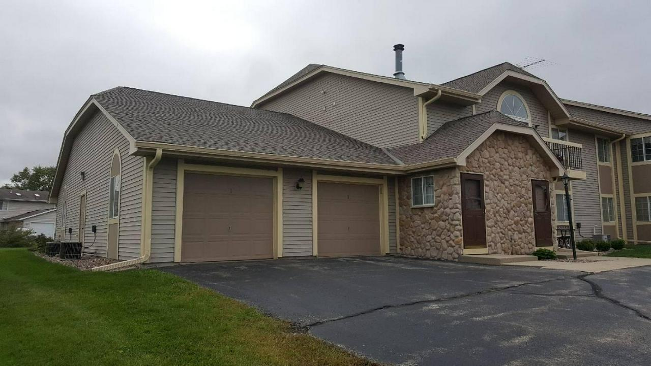 You will LOVE this 2 bedroom, 2 bath main floor condo in Slinger School district!  Some features are laminate flooring in great room, formal dining, kitchen with updated stove, refrigerator & dishwasher and master bedroom suite - includes walk-in closet & private bath with shower  On the lower level there is an office, family room and 2 extra rooms for storage or a workshop PLUS the option for laundry on main or lower level.  Excellent location - enjoy the view of the pond from your private patio!