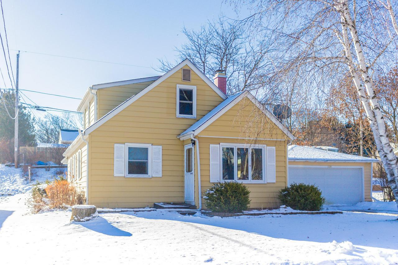 Charming Cape Cod within walking distance to Regner Park. This 4 bedroom 1.5 bath home features updated bathrooms, newer windows, large living room with natural fireplace. Beautiful family room that overlooks your fenced in backyard. Deep 2 car garage for extra storage. Recent updates include water heather(2018), Fence(2018), washer and dryer were purchased in 2018 as well! This one will not last long, schedule your private showing ASAP!