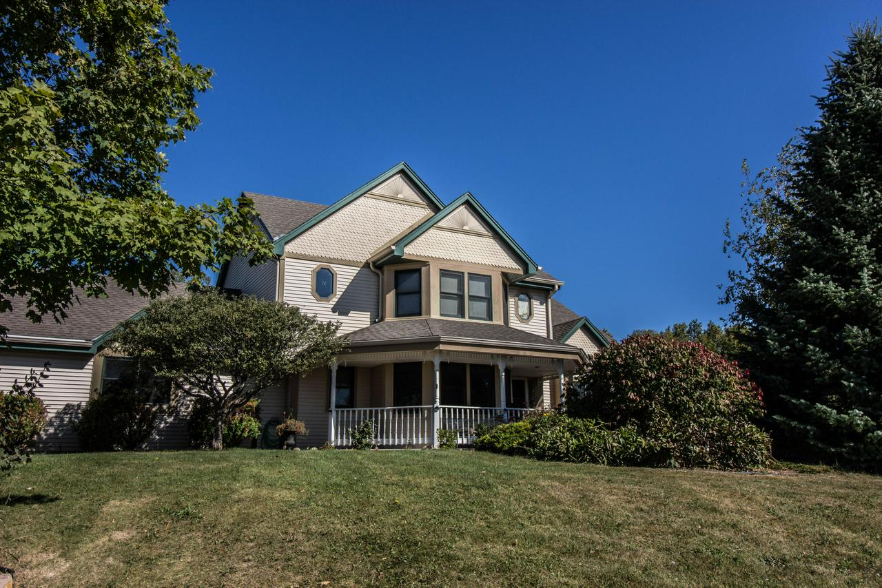 Enjoy country living on this rare 5 acre property that's tucked away yet close to everything Mequon has to offer.  This charming victorian style home features a wrap around porch, 3 BA, 3 BA. a gourmet kitchen w/ granite countertops & stainless steel appliances.  Enjoy numerous areas to entertain including the pool w/ surrounding deck, outdoor kitchen w/ pergola area, cozy fire pit area & lower level theater room.  Walkout lower level a plus. Property also has huge pole barn that's a dream come true for a woodworker, auto enthusiast or any hobby that requires a large space. Make this your own!