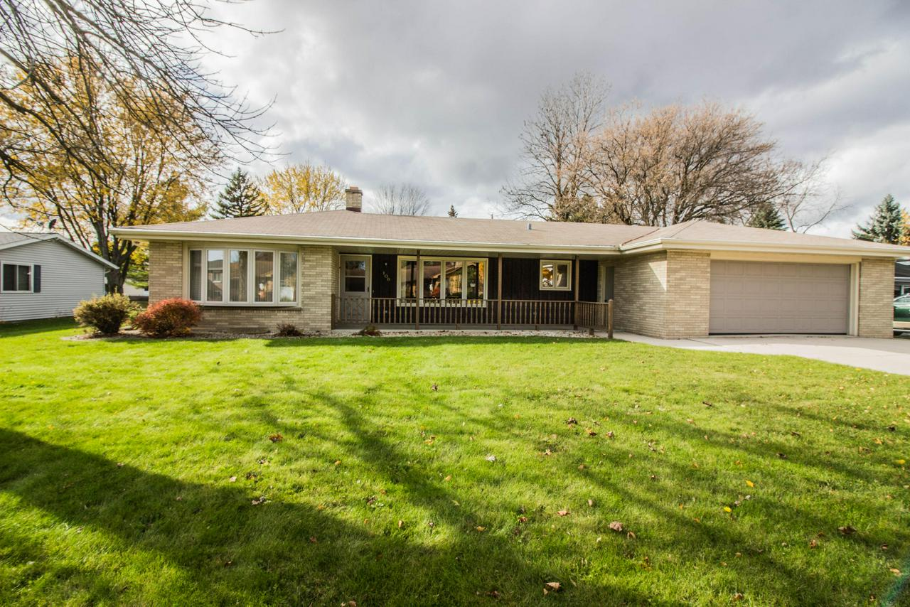 Original owners built this solid 1967 brick ranch style home & now it's time for a new family to enjoy it. Bring your ideas & decorating colors to make this your own.  This nicely maintained  home has 3 bedrooms, 2 full bathrooms on main floor with a half bath in the finished lower level.   Enjoy a large family room & living room.  Master bedroom has ''His & Her's'' closets & features ensuite.  The 2nd & 3rd bedrooms have built in desks with lighting.  Massive lower level is ideal for entertaining during the winter & huge patio is great for summer entertaining. Home has nice covered front porch & central vacuum is a plus.  Close to beautiful Harrington State Park & I-43  for commuters.  Make this your own!