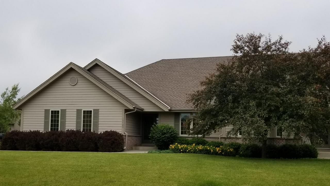 Former model condo loaded with quality features. Vaulted ceilings throughout. Large eat-in kitchen plus a formal dining room. All stainless steel appliances included. Great room has natural fireplace. Full basement is unfinished.