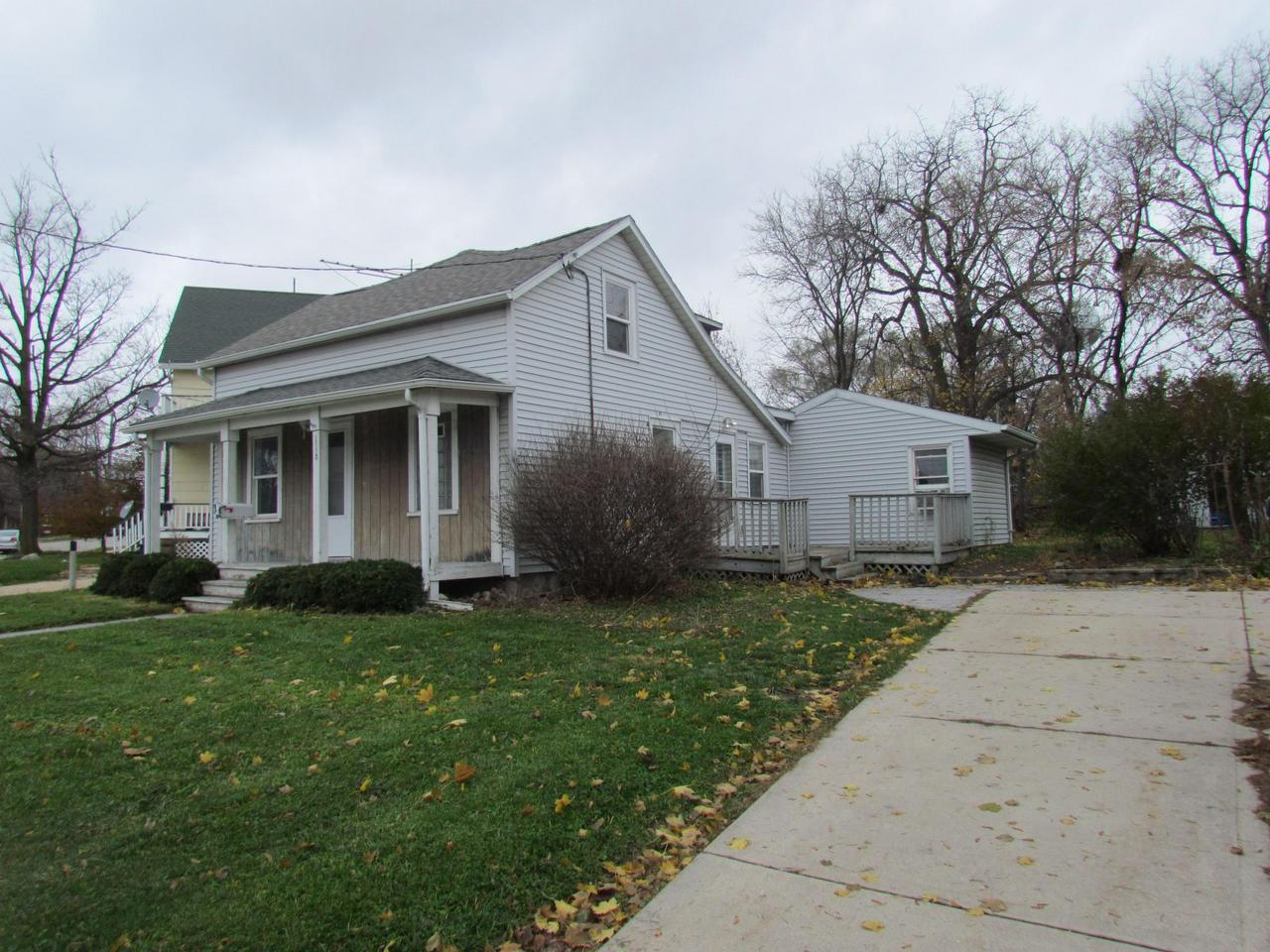 The possibilities are endless with this 3 bedroom 1 bath home. Bring your ideas and make this one shine again. Main level offers Sunlit LR w/newer carpet. Bright eat in KIT w/snack bar, and 1 bedroom. Upstairs you will find a den/office area, and 2 bedrooms. Side deck, cute front porch, private yard w/shed.All appliances are included. 1 year home warranty included through HMS (a $489 value)
