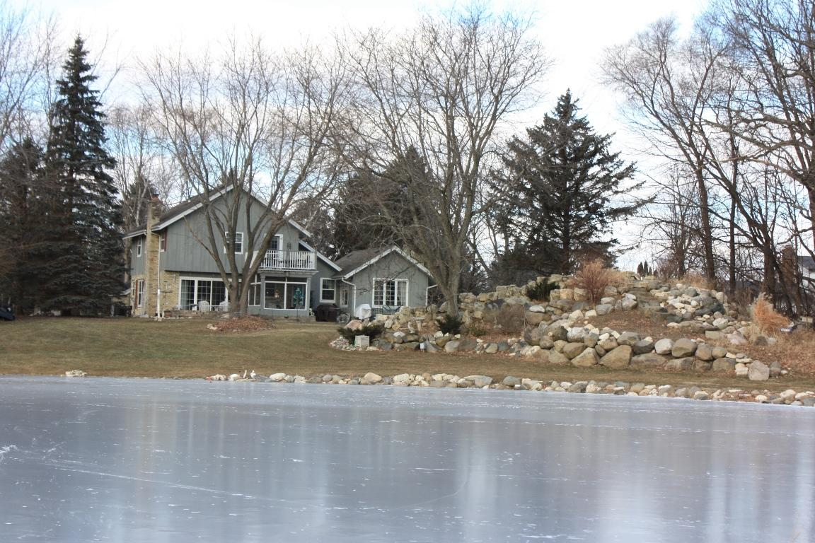 First time offered; make this home in a country subdivision yours today!  This spacious home has 3.5 bathrooms, partially finished lower level with rec area & bar room that could be used as 4th bedroom (egress window).  Home features 2 fireplaces, 2 furnaces, 2 central air units, Matured landscaped yard with waterfall (pumps included) and pond.   White trim and doors throughout home.  Formal LR has french doors, built in shelves & natural stone fireplace w/raised hearth as focal point.  Family room off kitchen has NFP , french doors and patio door with southern exposure and view of landscape & pond.  Formal dining features crown molding & Ashford style wainscoting w/chair rail & laminate floor.