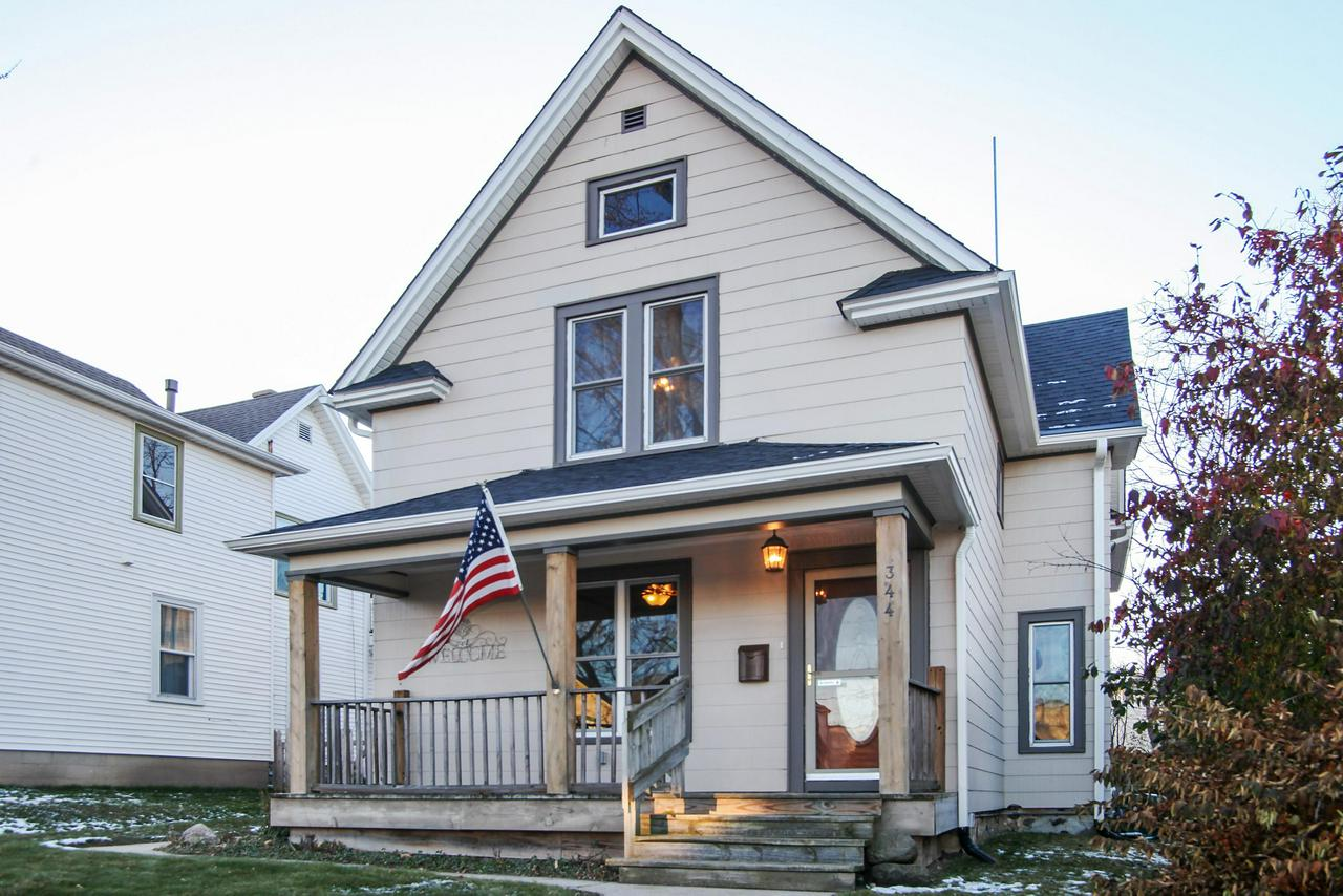 A downtown treasure of yesteryear is conveniently located to enjoy the library, restaurants, shops and events such as the Farmer's Market, Music on Main, and downtown events. This well maintained home is the perfect blend of modern updates that complement the quality and detail of the original woodwork, high ceilings, crown molding and beautiful built in cabinets. The delightful sunny kitchen is the central hub of the home and is perfect for preparing meals for special occasions or family time making Christmas Cookies. Additional Features and Updates: Walk-in Pantry, Sunroom, Fenced Backyard, Stainless Steel Appliances, Newer Windows, Roof (2014) Gutters & Ice Dam Heater (2018) Drain Tile (2007)