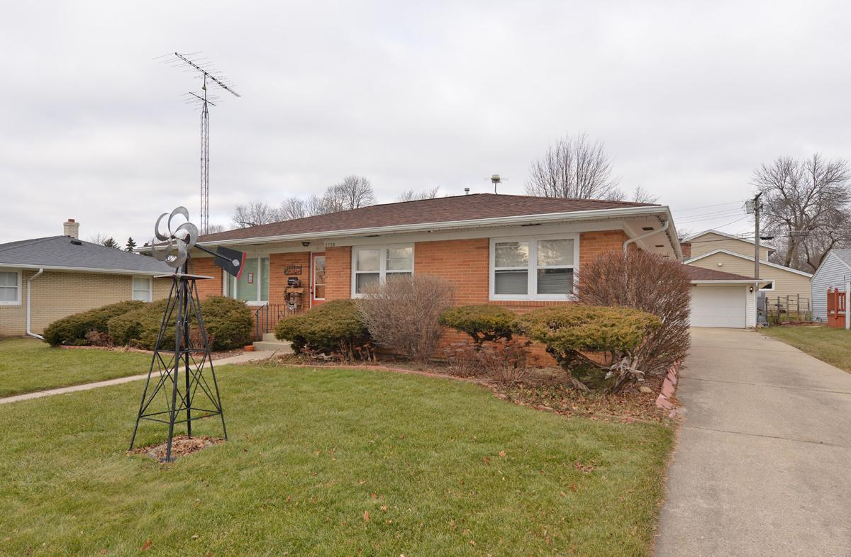 Move in ready brick ranch on the north side. This home features 3 bedrooms with hardwood flooring, a partially finished basement, and a nicely landscaped backyard with a 2.5 car detached garage.