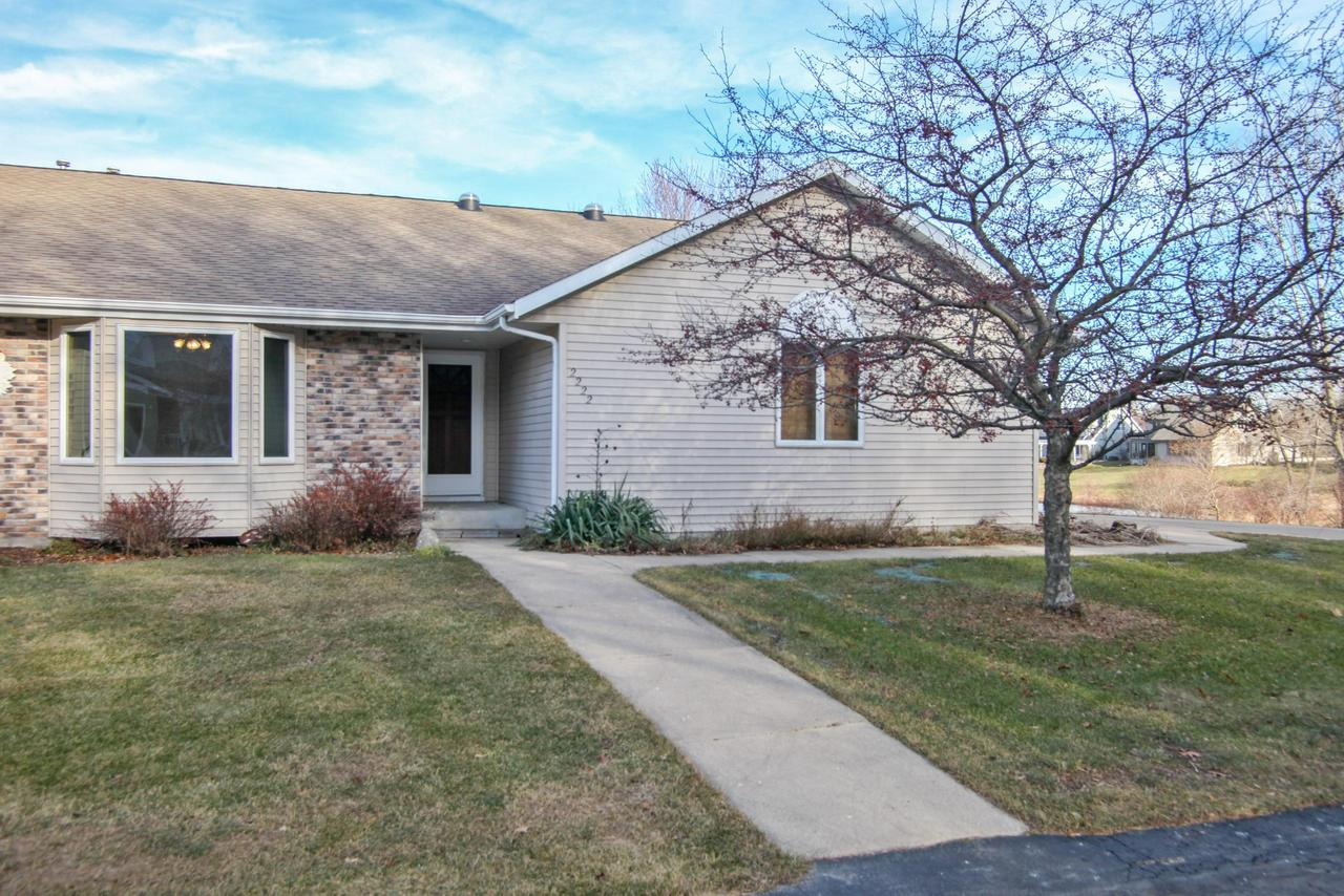 ''WOW'' is the best word to describe this 2 BR,2 BA condo located on quiet dead end street.  Kitchen has ceramic tile floors, cath ceiling, solar lights,  ample cabinets, lg dining area + opens to living rm.  Living rm has  brick gas fireplace, laminate flr + patio doors that open to spacious deck which overlooks Little Spring Lake.  Both bedrooms are spacious and have 2 closets.  Convenient 1st floor laundry. Entire condo has been freshly painted + new 6 panel solid oak doors installed.  Other updates include furnace-2017 + water heater-2018.  Annual condo fee of $450.00 is paid annually+ covers maintenance  of common area+ plowing private road.  Condo insurance billed separately in late March and was $387 last yr., Lake association fee $150. Pets ok. A ''True Value''--Price to Sell Fast!
