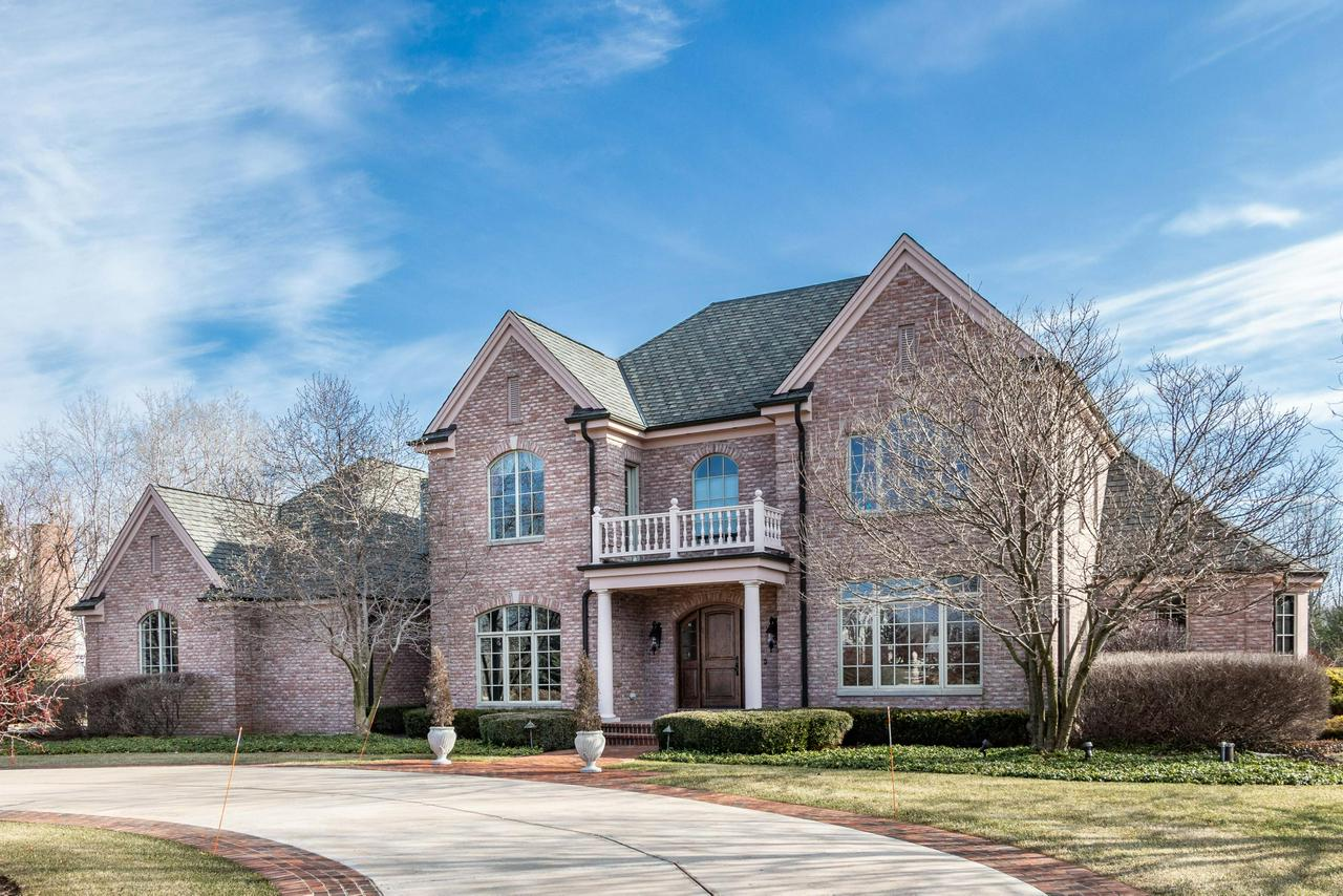 Stunning, custom build by Lakeside Development set on just under 2 acres and abutting Cedar Creek. Beautiful setting in this French Country estate, 4+ bedrooms, no detail left untouched, meticulously maintained and cared for home. Classic Chef's KIT w/large island, prep sink, top of the line appliances & large pantry. KIT opens to FR and cozy hearth rm with NFP. 3 season porch w/NFP  is a huge bonus for entertaining. Additional sunrm w/wet bar & 1st floor home office. Upstairs lg mstr suite w/GFP and sitting area. Very well planned design of the mstr BA, dual vanities, soaking tub and walk in shower. heated floors. Walk in closet. 2nd floor laundry. 3rd floor balcony for viewing the Creek with a glass of wine or coffee. Theater room, rec room & wine cellar. Must See! Impressive!
