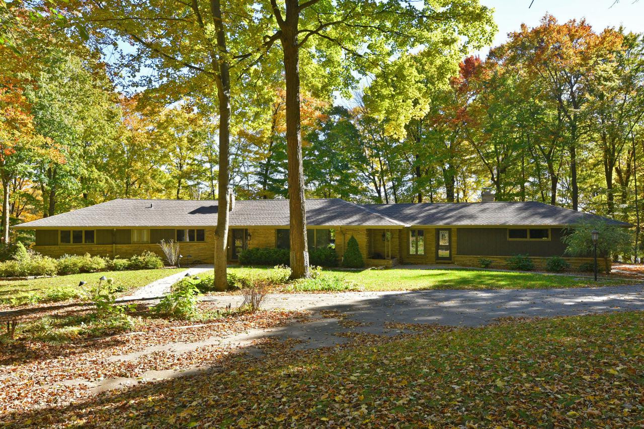 First time ever on the market! This classic Lannon stone ranch home sits on nearly three acres, perched above Cedar Creek on a private wooded lot! The Mid Century decor is a testament of its timeless beauty. The jewel of the home is fabulous all season sun room with its stunning walls of glass that bring the beautiful surroundings inside. Spacious rooms include a large kitchen with a big center island with a snack bar and updated appliances. There are four large bedrooms, and a large main floor laundry room. The walk-out lower level features gorgeous stone fireplace and additional rec room, plus lots of storage. Oversized garage with cabinets, top quality throughout and outstanding condition. All located within the City of Cedarburg! This is the home you've dreamed about!