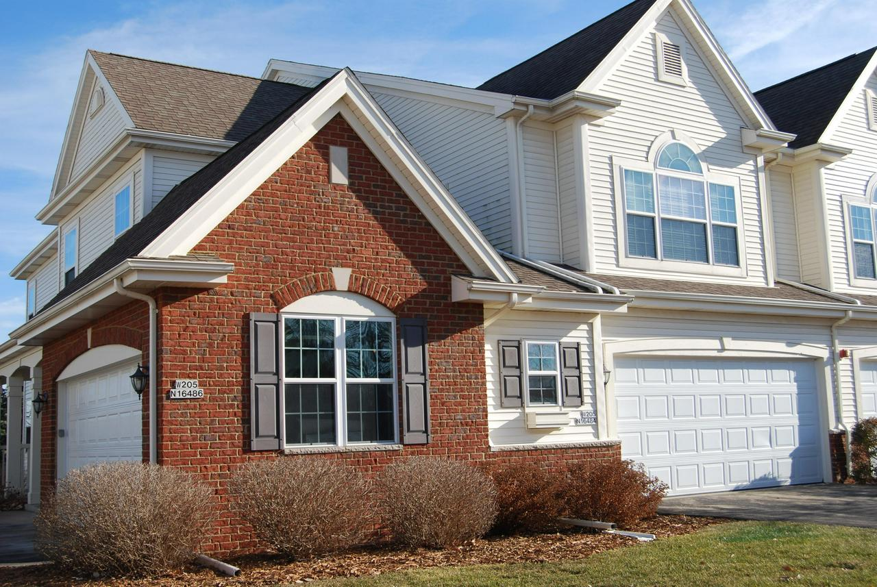 Beautiful 1st Floor 2BR/2BA Condo in desirable Cranberry Creek! HUGE - OPEN CONCEPT - Main level condo with FANTASTIC FLOW THROUGHOUT! Relax on the patio facing the village park or cozy up in front of the gas fireplace in great room. Spacious kitchen with ample cabinetry+Pantry and snack island ready for your stools. Formal dining area to entertain in style, Large bedrooms/Master Suite w/private full bath and WIC, Finished lower level with egress window plus separate 18x18 storage also plumbed for 1/2 bath. Laundry On Main, No steps on main level, and an attached 2 car garage. COUNTRY CLUB STYLE LIVING with Club house, Gated outdoor in ground pool, 24 hour fitness center, walking distance to the new village rec-center. Pets ok - Bring your LOVED one along!