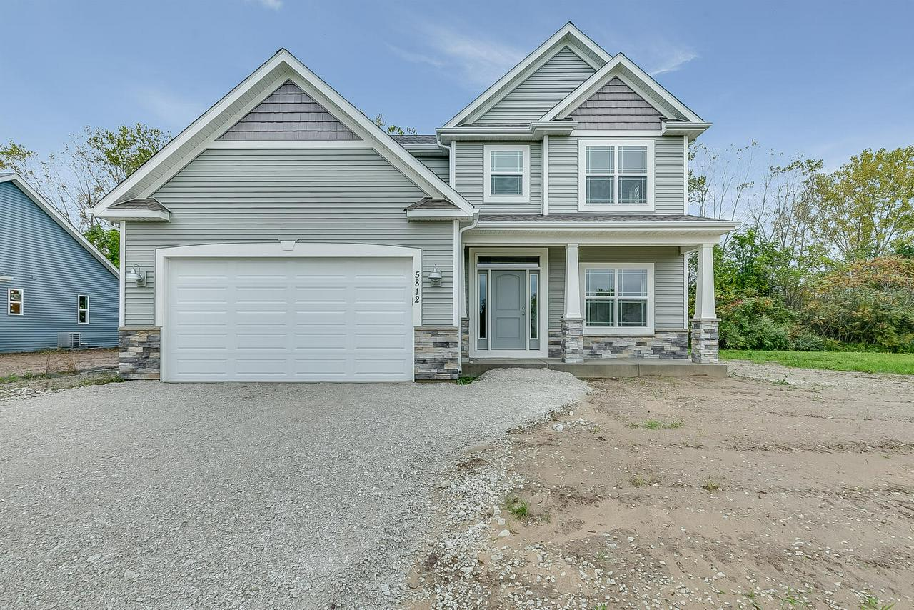 This Wellington II offers 4 bedrooms + main floor 5th bedroom OR office along with open floorplan great for entertaining. 1 yr builders warranty and 15 yr dry basement warranty. Concrete driveway and seeding included. Gas fireplace and KOHLER plumbing fixtures. 3rd party tested by Focus On Energy.*Taxes based on land only.*