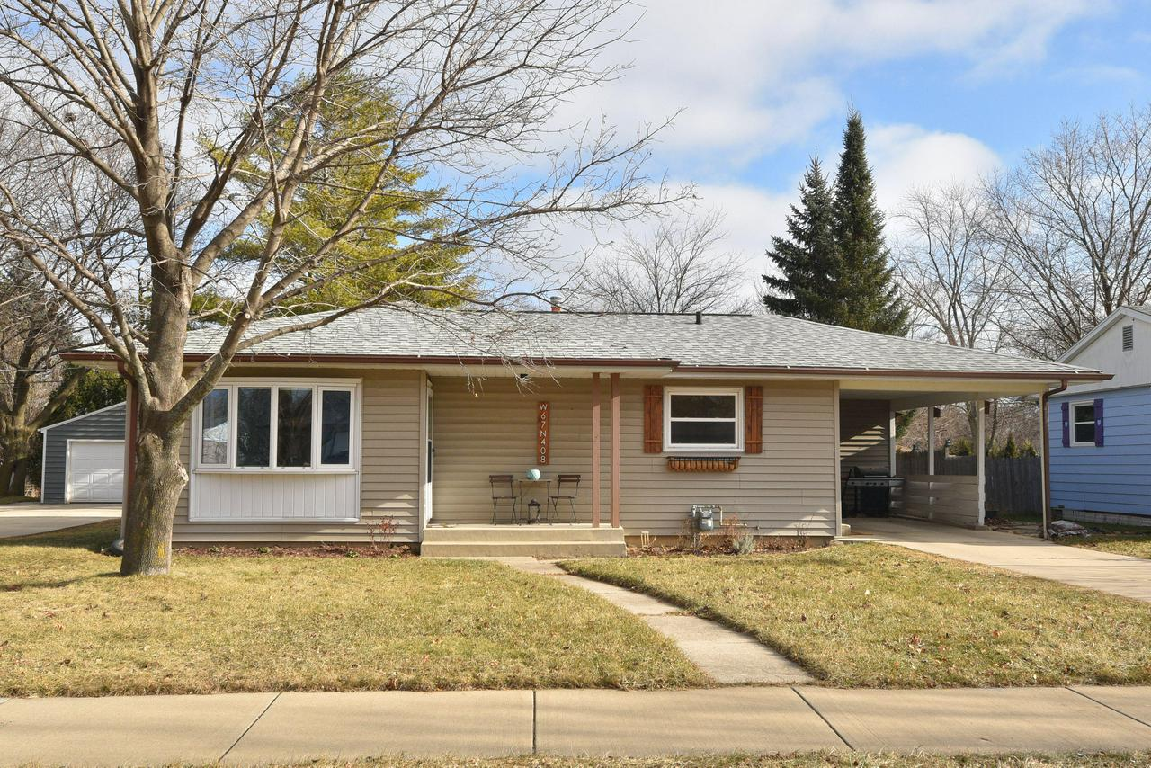 This adorable Ranch home is ready for any buyer to move right in! It has updated quartz kitchen counters  and beautiful neutral colored flooring and paint.  There is a covered car port for 1 car attached to the home at the end of the driveway.  Great Cedarburg location, close to down town! Call today to schedule your showing as this one won't last!