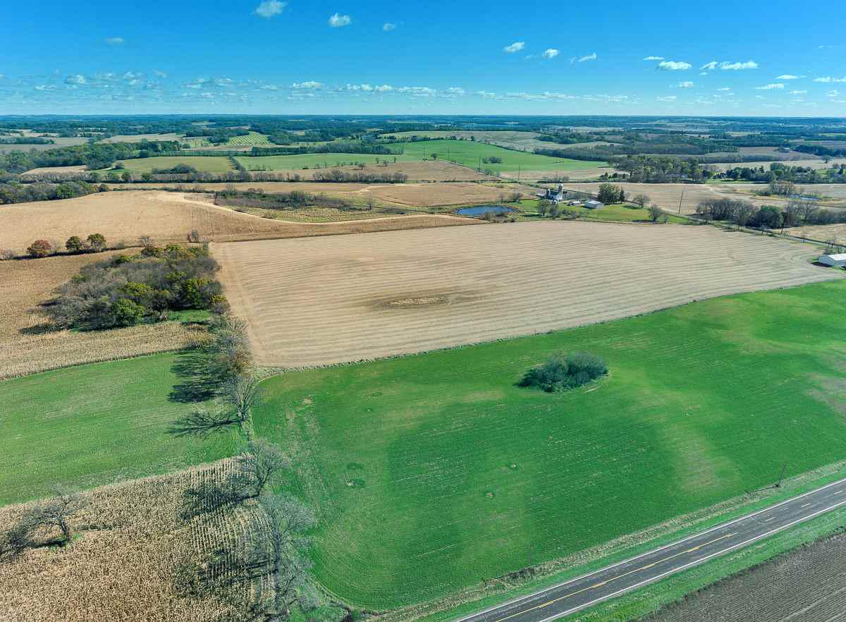 Dream of County Living? Perfect opportunity to own 46 acres of Farmland located in the City of Fitchburg. 1085 sq ft, 3 bedroom, farm home (over 100 years old) is waiting for you to put your own stamp on it. House is being sold ?as is?. 2 detached sheds measure?s 30?x40? & 40?x63?. The homesite is on 1.48 acres, the farmland is on 45 acres has been leased for $10,000/yr. Property has gentle sloping terrain with a intermittent meandering stream. Crop production is the highest and best use of the land.  Enjoy hunting or watching nature. The property can be also be sold with 120 acres. See MLS #1844313.