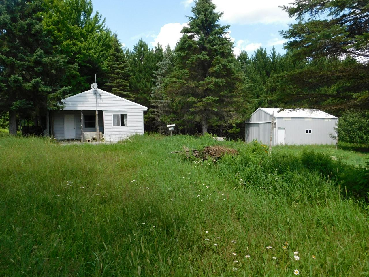 Hard to Find 350 Acres of Contiguous Hunting w/Cabin & Pole Building! Has sand point well, conv. septic system, electricity, approx. 10 ac. Food Plots, High & low land, Thick Deer Holding Habitat  & creeks traversing through property & agriculture fields in the immediate area means food, water & cover for Deer, Bear & Wildlife. Great trail system in place for accessing parcel along w/expired railroad tracks. Property adjoins Nicolet Forest & has great ATV/Snowmobile trails nearby. Recreation Paradise! Property not zoned. Appliances, grain drill & quack digger negotiable. Seller willing to divide parcels to sell 120 ac w/cabin & shed for $195,600 and 230 acres land only for $299,900. Call Today!