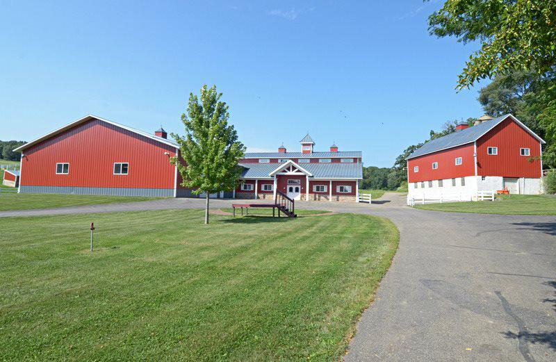 Stunning Equestrian Farm just South of Madison! 180 acres with state-of-the-art horse barn that includes 9 stalls, fly spray lines, washing station, 128'x72' indoor arena, viewing room with kitchen & bathroom. Adjacent is expansive machine shed 88'x45' & hay barn. 7 fenced-in pastures with water & multiple loafing sheds. The 3 bed/3 bath home sits atop the hill overlooking the property. Floor plan includes a large kitchen & dinette flowing to formal dining room and living room with fireplace. Bedrooms provide adequate space for family and guests. Finished lower level. Additional 40 acres available to purchase.