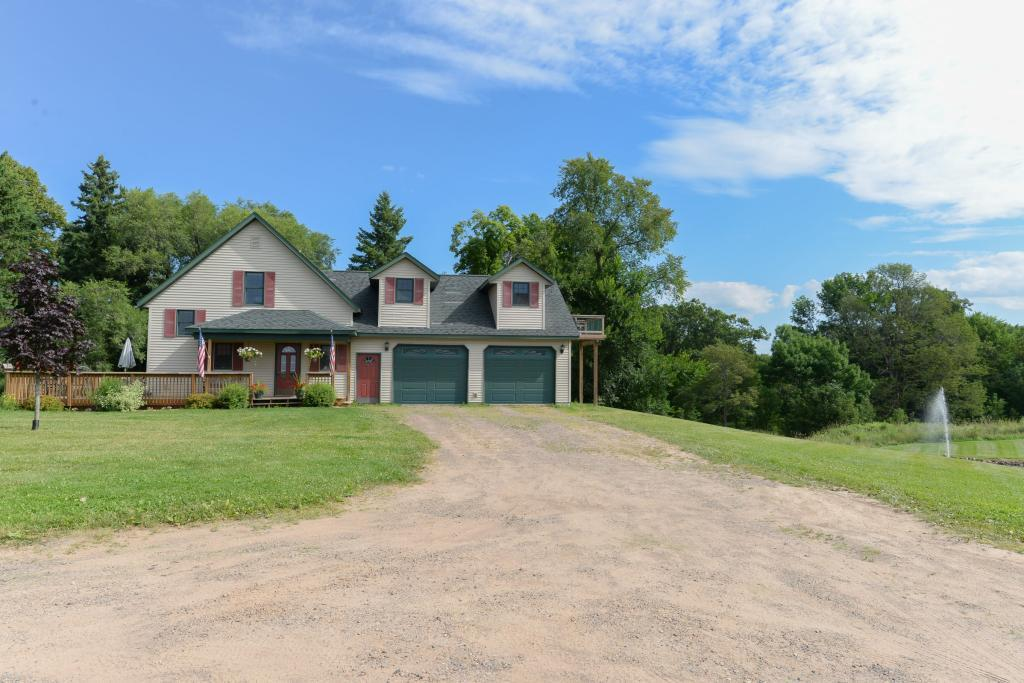 Fabulous stylish Kentucky style professional horse farm on 36 acres w/ add'l 15.69 close by for add'l horses or tillable (51.97 acres tot.) This house has been fully renovated with a large master bedroom and master bath in one 1/2 of the house as the balance still shares two addt'l bedrooms and updated/renovated bath. LL has had a full overhaul to create a grand chef's kitchen and added enclosed 4 season porch and fully renovated garage & fully renovated  Kentucky style barn w/ full size arena/custom 10 stalls. It hosts a training barn, indoor riding arena, tack room with full equipped laundry facilities, wash stall and customer lounge. There are three addt'l outbuildings on this property including: 6-stall overhaul barn, heated workshop, & high-bay workshop with attached two level caretaker quarters. Grounds include full fruit orchard, 10+ acres of paddocks with new vinyl fencing and pastures with new loafing sheds. Furniture, equipment & more avail as part of sale. A jewel of a find!