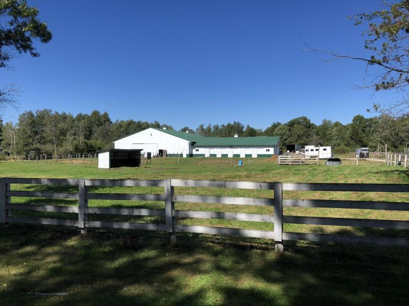 ATTENTION ALL HORSE LOVERS! Make your dreams come true with this unique opportunity to purchase this 11,440 sq ft equestrian barn and indoor heated riding arena with 9 stalls built in 2001. These barns were built with no expense spared. Facility includes a washing area, tack room and office space with a window to the indoor arena. Fenced in pasture area with electric fence already in place.