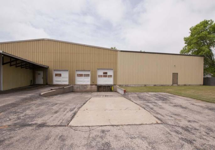 Peshtigo City Zoned Commercial Warehouses with 14,000 apx sq ft or under $20.00 per sq ft! Seller is considering all offers! Affordable, steel construction, wood construction, metal roofs, semi drive-in capable, heated, office space, two bathrooms, storage basement w/conveyor belt, large ceiling fans, concrete floors, several overhead doors and 32 ft drive-in cooler! Convenient location, plenty of green space for turning around semis and parking. More details in documents.