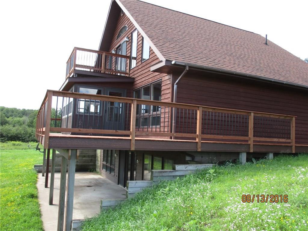 Beautiful cedar chalet with open loft, tongue & groove pine interior, 3 bdrms & 2.5 baths. Full walkout lower level finished with huge family room and 2nd kitchen. Loft features catwalk to a private deck to view the water. 3 season porch off the main level for a great added view. Garage is 26x36 and has a workshop. All on 1.86 acres with 187' of frontage on Miller Lake! Fantastic large yard for enjoying the outdoors.