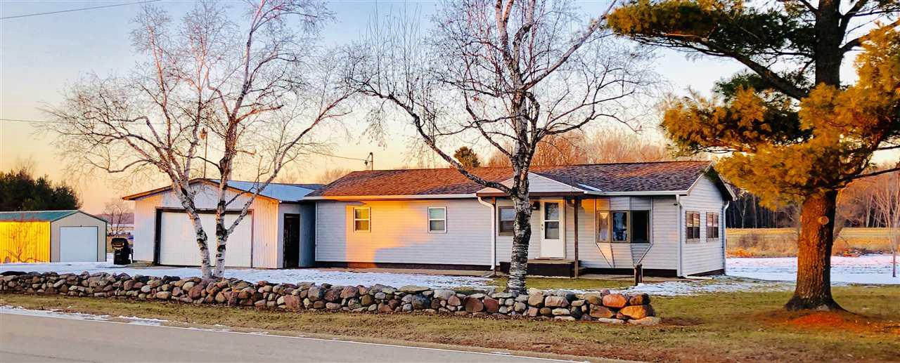"""Country living near the city. Enjoy the sunsets & abundance of nature in this remodeled 3 bedroom ranch. Beautiful stainless/slate appliances, solid maple floors, nearly all new windows. Deck overlooks 4.8 acres with pond, fruit trees & approx. 200+ starter tree farm/woods. Maple, oak & pine saplings. A 14 x 30 Miller Barn awaits your toys. A fenced area awaits your dogs, goats, chickens or garden. Outdoor wood furnace by Central boiler """"top of the line"""" per seller is an additional heat source. The 16 X 21 wood shed has power to building. Perfect location minutes to the Valley & Clintonville."""