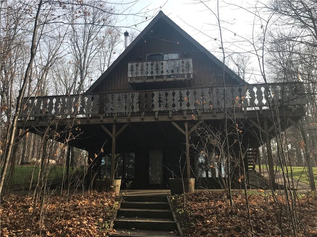 Wonderful 4 bed, 3 bath chalet home, walk-out, 1/2 log siding, granite counters, vaulted ceilings, large deck, patio, balcony, asphalt driveway, plus 4 car 36x40 garage with 14x40 loft.  Private setting with island lake view.