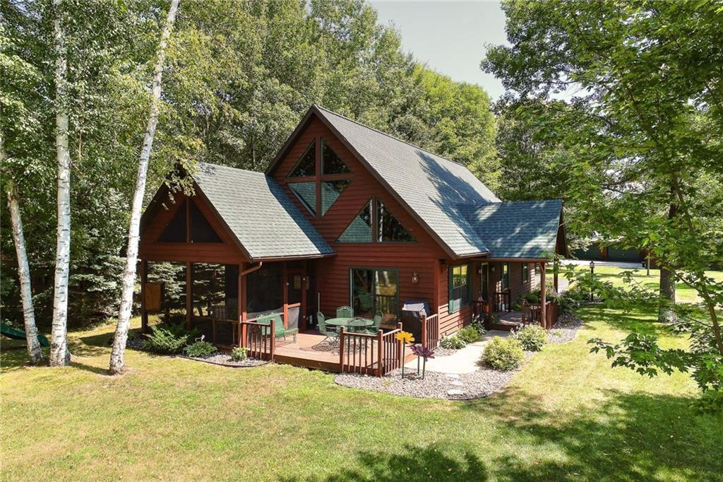 Over 3800 acres of water to roam-3 lakes/3 rivers/6+ restaurants/bars. Fabulous views w/low bank to water. Tastefully landscaped. Well maintained home tucked in the trees.  Make your main stay or 2nd home. Open concept kitchen/dining/living. Main floor master suite w/dual sinks & therapeutic tub. Upper loft w/large family room & bedroom w/tons of storage. 32x44 detached garage. 24x24 workshop. New appliances. Screened in patio w/wood deck overlooking the Lake. Relaxing gas fireplace.